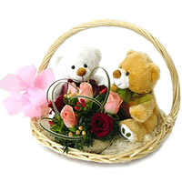 2 Teddies with flowers in a basket