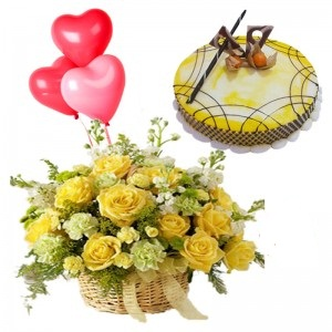 1/2 Kg Chocolate Cake+3 Red Heart Balloons+12 Yellow Roses + Celebration Pack