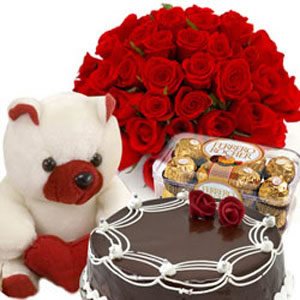 12RedFlowers+Teddy+16 Pieces Ferrero Rocher+1/2 Kg Cake
