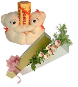 2 teddies Toblerone chocolates and 6 pink Roses